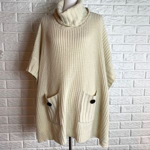 Cream turtleneck poncho sweater